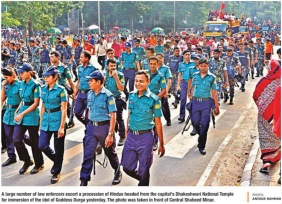 Police security infront of Durga procession Star Oct 24, 2015 - Copy