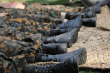 Bodies of Bangladesh Rifles (BDR) officers are layed on the groud of a park in Dhaka, Bangladesh, on Feb. 26, 2009. At least 73 people, including 57 army officers deputed at the paramilitary force, were killed in the two-day bloody revolt in Bangladesh capital on February 25-26, 2009. The uprising was first staged at the BDR Headquarters in Dhaka over low pay and poor condition, and it sparked off mutinous demonstrations in other establishments of the border force across the country. Some 3,500 border guards have been accused in some 40 cases in connection with the rebellion around the country and around 4,000 BDR soldiers were arrested and set to be tried on charge of the mutiny. Photo: Qamruzzaman