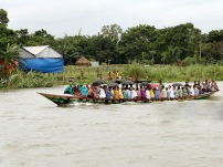 Savar, Bangladesh - September 21: People crossing the Bangshi River on a boat on September 21, 2015 in Savar, Bangladesh. (Photo by Thomas Koehler/Photothek via Getty Images)