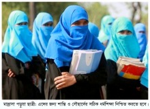 Students of a Madrasa, or Islamic school,  look on as they wait for transport at Teknaf, about 316 kilometers (196 miles) south of Dhaka, Bangladesh, Sunday, March 7, 2010.  International Women's Day will be observed on Monday. (AP Photo/Pavel Rahman)